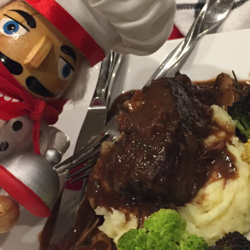 Pepé (the nutcracker who looks like a chef) next to his finished dish of braised short ribs in a mushroom wine gravy, mashed potatoes and roasted broccoli