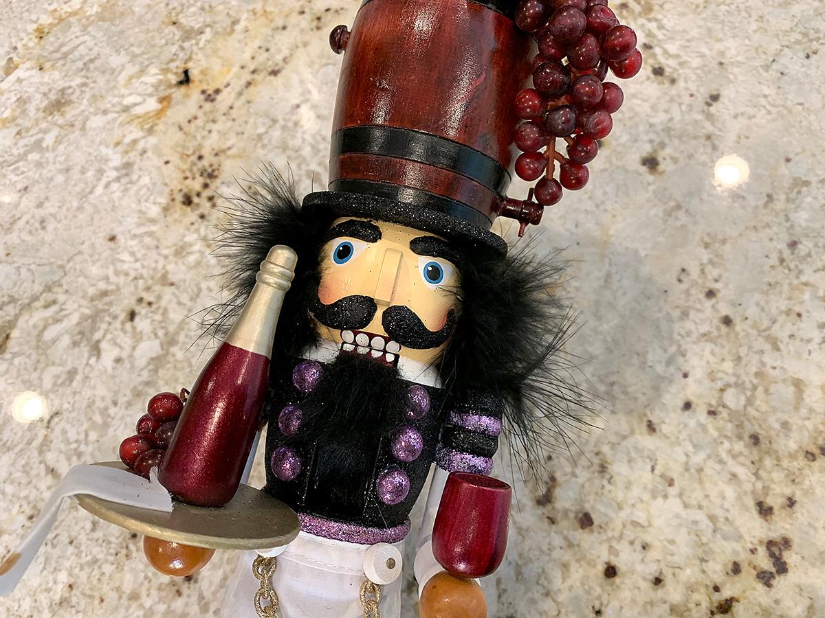 A nutcracker who looks like a wine expert.