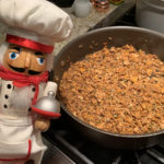 chanterelle duxelles in a skillet with a nutcracker that looks like a chef