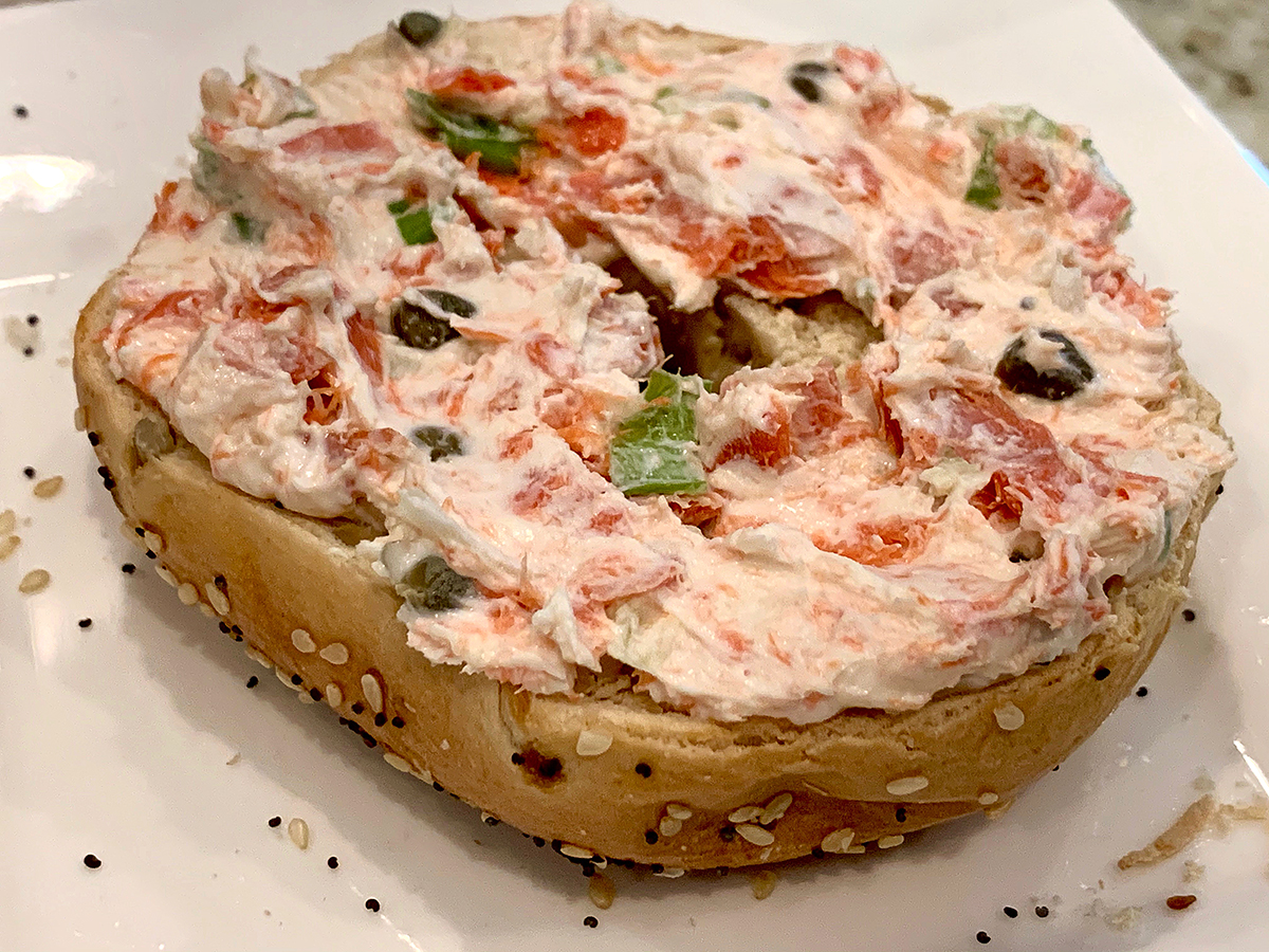 Smoked salmon spread on an everything bagel.