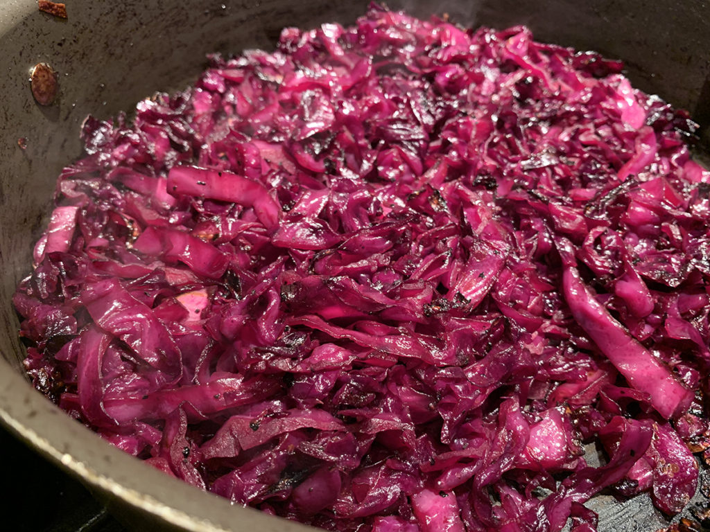 Fried red cabbage in a skillet